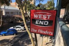 west-end-sign-side